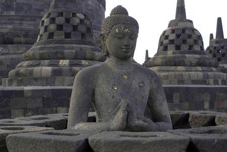 stupas: Buddha and stupas in Borobudur, Java, Indonesia                Stock Photo