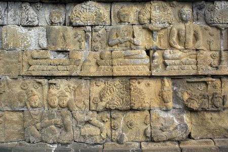 incarnation: Buddhas on the wall of Borobudur, Java, Indonesia                 Stock Photo