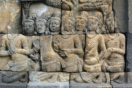 People on the wall of Borobudur, Java, Indonesia                photo