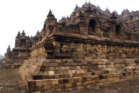Corner of historical buddhist monument Borobudur, Java          photo