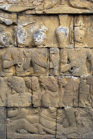 Figures on the wall of Borobudur, Java, Indonesia                     photo