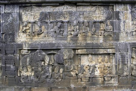 Stone picture on the wall of Borobudur, Java, Indonesia            photo