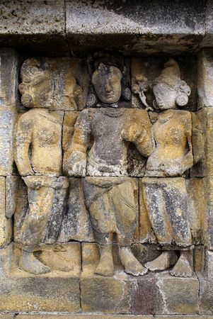 Women on the wall of Borobudur, Java, Indonedsia                 photo