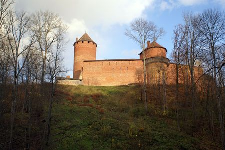 sigulda: Forest and red brick castle on the hill in Sigulda, Latvia                   Stock Photo