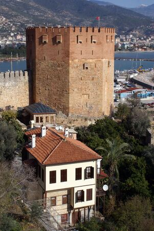 Red tower and houses on the sea shore in Alanya, Turkey Stock Photo - 4241881