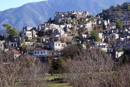 kayakoy: Orchard and ruins of houses in village Kayakoy near Fethie, Turkey