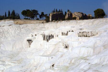 carbonates: Travertine mount and trees in Pamukkale, Turkey               Stock Photo