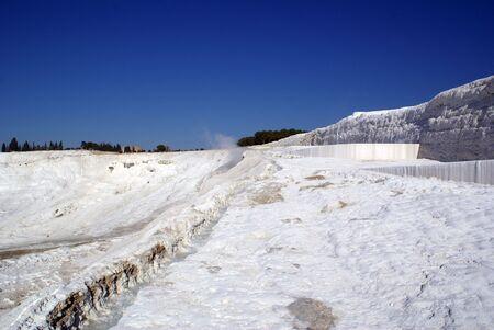Travertine and slope of mount in Pamukkale, Turkey                      photo
