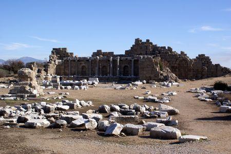 near side: Ruins and sand in Side near Antalya, Turkey