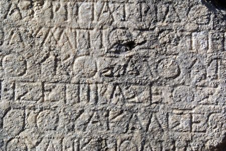 Greek letters on the marblewall in Phaselis, Turkey             photo
