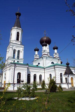darck: White church with darck cupolas in Mogilev, Belorussia                  Stock Photo