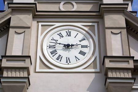 catholocism: Big clock on facade of catholic church in Odessa, Ukraine