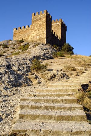 sudak: Steps to the tower of castle on the hill, Sudak               Stock Photo
