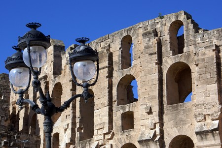Old street lights near the all of roman theater in El-Jem, Tunisia                 photo