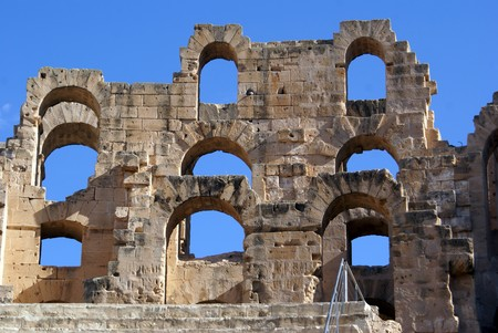 Wall of roman theater and blue sky in El-Jem, Tunisia          photo