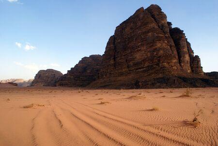wadi: sand and mount Seven Pillars in Wadi Rum, Jordan                 Stock Photo