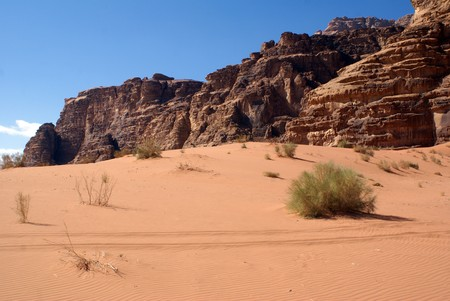 Red and, desert and rocks in Wadi Rum, Jordan                 Stock Photo