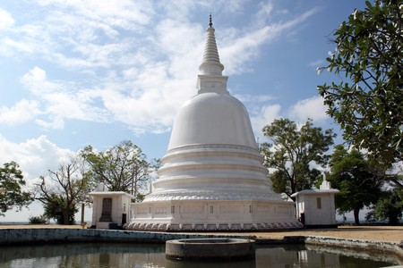 White stupa, pool and magnolia in monastery, Sri Lanka Stock Photo - 7575399
