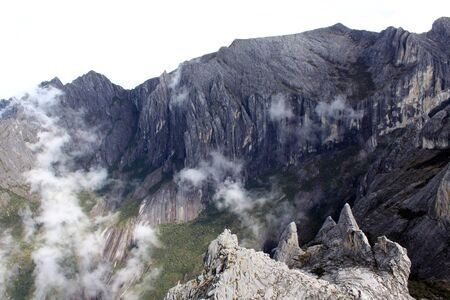 Clouds in crater of volcano Kinabalu in Sabah, Borneo, Malaysia photo
