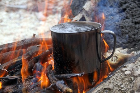 boiling water: Wood and boiling water in big campfire
