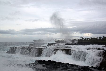 demolishing: Black lava and storm on the coast of Samoa