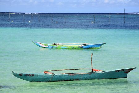 samoa: Two traditional wooden boats on the water in Upolu island, Samoa