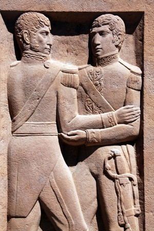 jose de san martin: Two soldiers on the wall of monument in Argentina