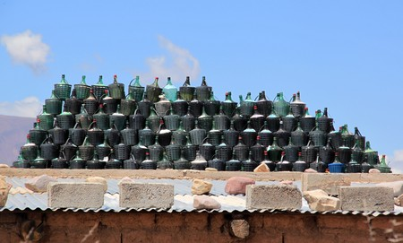 carboy: Group of wine bottles on the roof of house in arid climate Stock Photo