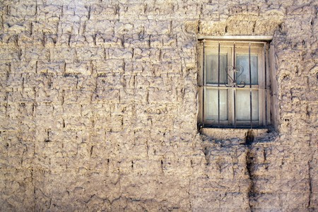 mud house: Mud wall and small window of house