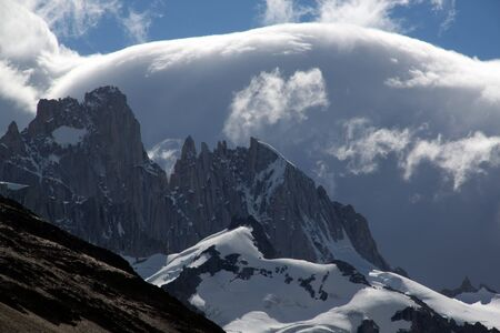 cerro fitzroy: Clouds and mountain in national park near El Chalten, Argentina
