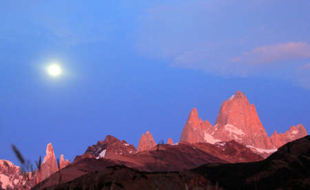 Red Fitz Roy, moon and mountain near El Chalten in Patagonia, Argentina photo