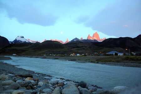 River, full moon and mountain near El Chalten in Patagonia, Argentina photo