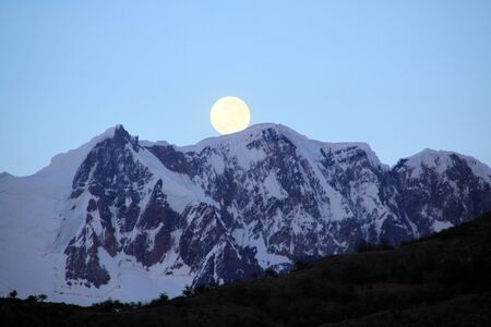 fool moon: Fool moon and mountain near El Chalten, Argentina