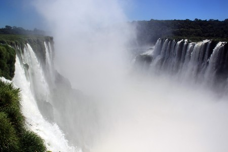Mist, grass and water in Iguazu falls, Argentina photo