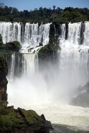 Cascades of Iguazu falls and rocks in Argentina photo
