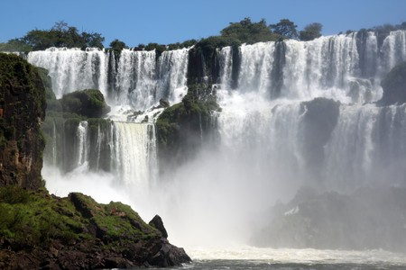 Tall and wide Iguazu falls in Argentina photo