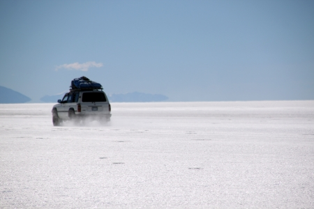 Four wheel drive car and salt lake Uyuni in Bolivia