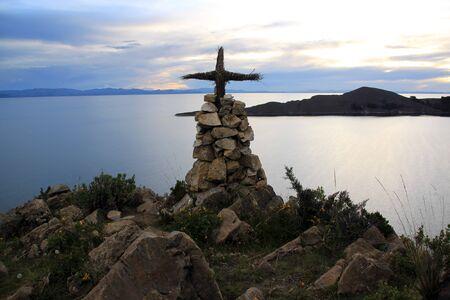 Small cross on the top of mount in island Isla del Sol, Bolivia photo