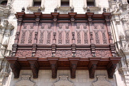 Balcony on fasade of old building in center of Lima, Peru photo