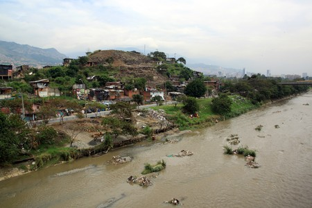 krottenwijk: River and slum in the city Medelyn, Colombia