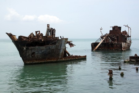 Rusty ships on the sea near the coast in Margarita, Venezuela photo