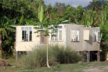 Broken house under the palm tree in Grenada Stock Photo - 7785517