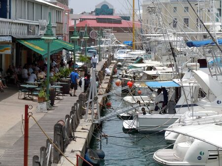 Cafe on the pier and boats in Bridgetown on Barbados           Stock Photo