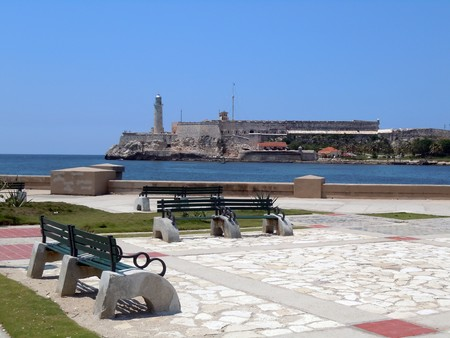 Benches on the sea coast and fort in Havana, Cuba           photo