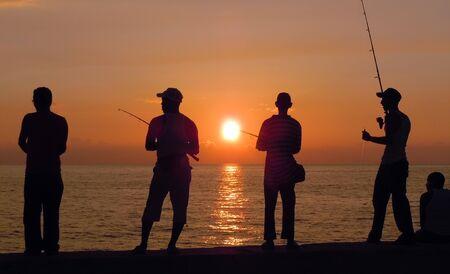 fishing scene: Fishing people on the coast in Havana, Cuba