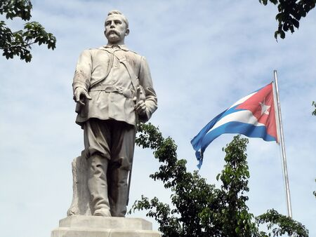 Statue of Jose Masrti and flag in Santiago, Cuba