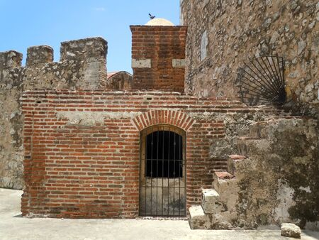 Brick tower and stone wall inside fort Ozama in Dominicana            photo