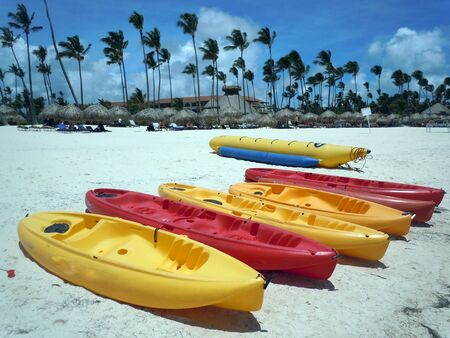 Yellow and red boats on the sand beach in Dominicana, Caribbean           Stock Photo