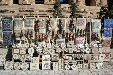 Souvenirs near wall of roman theater in El-Jem, Tunisia                 photo