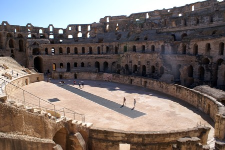 People on the stage in roman theater in El-Jem, Tunisia